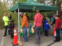 Visitors to Dawes Arboretum take home seedlings, compliments of Bartlett Tree Experts.
