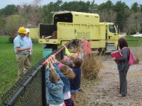 Some little ones at a school in Duxbury, MA learn about trees and get to check out a Bartlett truck!