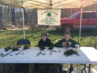 Members of the Victory Workers 4-H Club handed out 100 balsam fir seedlings in celebration of Arbor Day at the annual Spring Fling 4-H event in Chichester, NH.