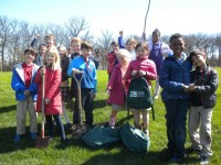 Students at Lake Forest Country Day School plant Arbor Day trees donated by Bartlett Tree Experts.