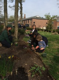 Earth day is a great day for students to get their hands dirty and learn about proper plant care.